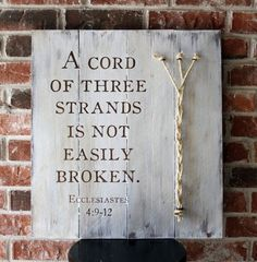 A Cord of three strands is not easily broken. (Ecclesiastes 4:9-12) - Distressed Wood sign with Rope Detail