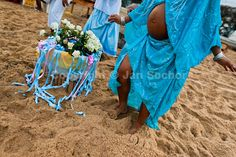 A pregnant Candomble follower dances on the beach during the festival in honor to Yemanjá, the goddess of the sea, in Salvador, Bahia, Brazil, 2 February 2012.