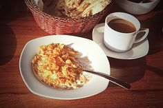 Corn flakes with milk and coffee served for breakfast by NadyaEugene Photography #Cornflakes #NadyaEugenePhotography #FoodPhotography #ArtForHome