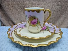 Up for sale is this Gorgeous Coiffe Limoges, Orleans, France hand painted three piece set, cup, saucer and under plate. Bright red and pink roses with lots of gold trim.Set was for display and not us