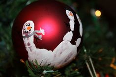 Cup of Daisies: Snowman Hand print Ornament