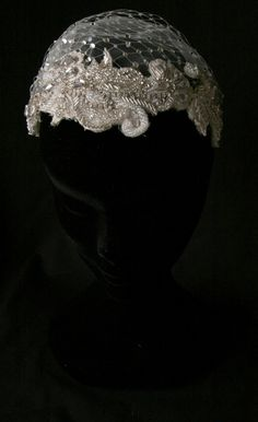 www.oliviaheadpieces.com APHRODITE.- A heavily beaded half cap headband adorned with a Swarovski crystals sprinkled russian netting and dotted tull.Beautifullydetailed, this piece gives gorgeous glamour to your vintage inspired look.    Available in ivory.