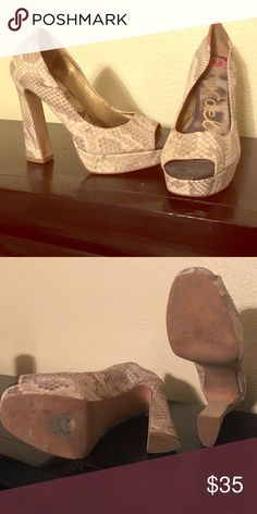 Sam Edelman Peep Toe Heels Snakeskin pattern Peep Toe heel, not snakeskin leather. Feels more like velvet than leather. Has brown leather patch on the back of the shoe. Sam Edelman Shoes Heels