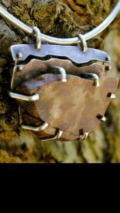My favorite piece!  (Yeah, I have favorites-LOL) Petrified wood & Sterling Silver. #Jewelry #Unique #WearableArt #OneOfAKind #Fashion