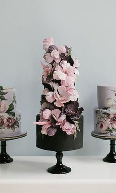Featured Cake: Nadia & Co; Unique pink and purple flower covered black wedding cake