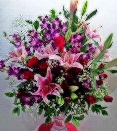 Orchid, lilies and roses...
