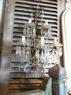 CRYSTAL SCONCES!! I AM IN LOVE!! Love the shutters too! Maybe find some to prop in the corner.