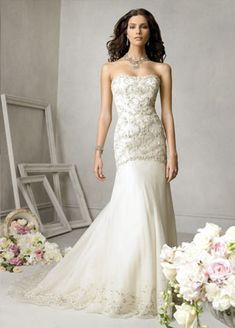 wedding gown- I like how non-poofy the bottom of this gown is...and how flowy it looks :)