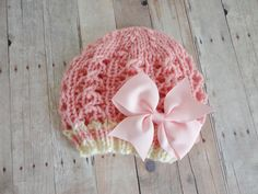 Newborn Beanie Hat in Pink and Soft White with Pink Satin Bow Shabby Chic, Newborn Photo Prop. $19.00, via Etsy.
