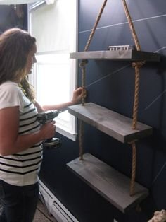 Monica securing the shelves in the boy's pirate-themed room.