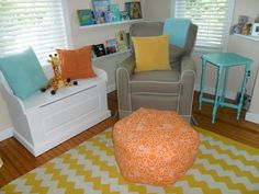 Love this yellow #chevron rug, especially with turquoise pillows & table in the #nursery.