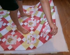 """How to Spray Baste a Quilt tutorial---I've used basting spray for years and really like it for small projects, like tablerunners, that I will machine quilt myself or do by hand. Watch out for """"overspray"""" and protect your surroundings! Get serious fold lines out of your batting by running it in a warm dryer with a damp towel for a few minutes."""