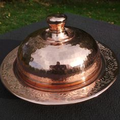 Sometimes when I am out at a flea market or Antique Fair I come across an item I havent seen before - this is one of those things. This cheese dome is hand hammered and hand engraved. It has a tin lining so it is safe for all foods - it is in wonderful condition and it is the first I have ever seen, it should be in my larder.........  The base has surface scratches from storage, the tin is hand wiped and all in all it is a lovely thing and will take centre stage on any buffet or dinner…