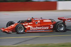 1984 Mario Andretti (#3) wins the IndyCar title, 15 years after winning the Indianapolis 500