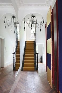Gold Carpet Stair Runner in Stair Carpet Runner Ideas. Modern hallway with contemporary decoration scheme, unusual chandelier and bold mustard carpet stair runner. Hallway Carpet, Carpet Stairs, Carpet Runner On Stairs, Coat Cupboard, Black Stairs, Dark Staircase, Stairway, Modern Hallway, Hallway Designs