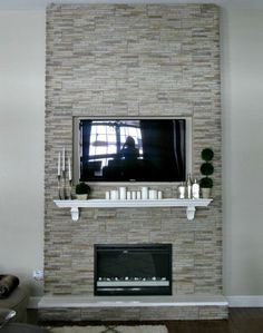 If you decide to rock the fireplace you could break the solidness with a mantel and then a mirror or have your TV set flush with the stone.