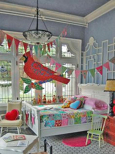 "Along with a local Vancouver children's furniture and furnishings shop (Molly's Furniture Salad), I helped decorate a child's bedroom with some of my wares (bed coverlets, pillows, banners)  for a Christmas fundraising event  held annually at turn-of-the-century Hycroft mansion in Vancouver called ""Christmas at Hycroft"". More details here: rosehip.typepad.com/rose_hip_blog/2009/11/stitches-and-su..."