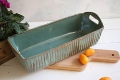 Ceramic bread pan, cake pan, bakeware, loaf pan, kitchen and dining, dining and serving. This pan is made from a dark brown stoneware clay. I use this loaf pan for baking bread and cake. I bake the cake , slice it and then serve to the table in the pan. The bread/cake bakes nice and