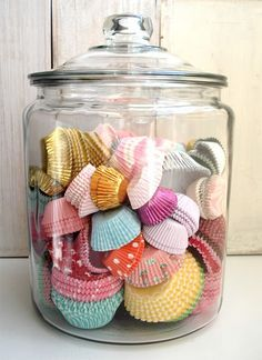 Pretty decor idea for bakers. Put your colourful cupcake liners in a glass container