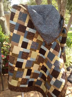 "good guy quilt possible for @Charley Andrews, ""disappearing 9 patch"" in random colors."