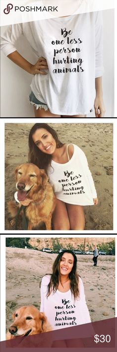 """Be One Less Person Hurting Animals Long Sleeve Tee Show off your love for animals with this size medium white thin loose fitting t-shirt with message """"Be One Less Person Hurting Animals"""". Has a scooped collar that can be worn off the shoulder if desired. Looks cute with a tank or tee underneath as it's a sheer material. NOTE: no tags came with this shirt as it was a mail order item. Proceeds from my sales go to dog rescue. Tops Tees - Long Sleeve"""