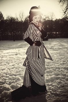 Black and White Stripes. Whited-out Face. Night Circus