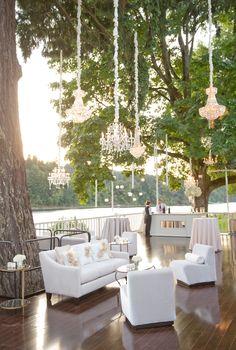 Outdoor luxury living room lounge with hanging chandeliers. wcep.com