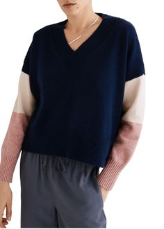 Color blocking is an easy way to experiment with your wardrobe and play around with fun colors. This sweater eases into color blocking with a navy blue and rose-pink sleeve combo. #fallfashion #falloutfits #fallsweaters #cutesweaters #southernliving