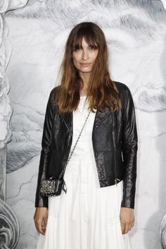 Her: caroline de maigret  Her look: biker leather jacket + white dress