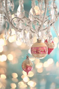 Vintage Pink Ornaments Hang From A Sparkling Chandelier