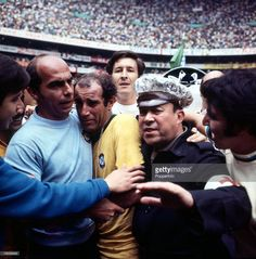 Football, 1970 World Cup Final, Mexico City, Mexico, 21st June, 1970, Brazil 4 v Italy 1, An emotional Gerson, scorer of Brazil's second goal, is escorted off the pitch at the end of the match as crowds invaded the field to mob their heroes
