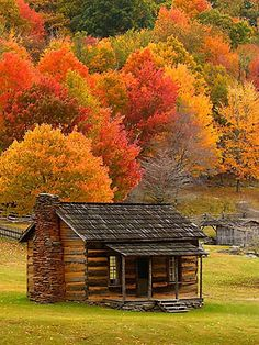 Stock Photo of settlers homestead log cabin fall foliage photographed