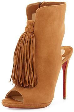 """Christian Louboutin suede bootie with hanging fringe. 5"""" covered heel. Open toe. Cutout vamp and backstay. Side zip eases dress. Signature red leather sole. """"Ottaka"""" is made in Italy."""