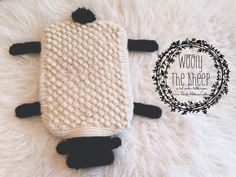 """Winter is here and Wooly the Sheep is ready to keep your feet toasty warm! Knit in a 5 stitch garter bobble, Wooly has a """"more hot"""" garter side and a """"less hot"""" bobble side and is seriously cute in the bargain! Christmas Knitting Patterns, Crochet Patterns, Crochet Ideas, Crochet Christmas, Crochet Bags, Crochet Motif, Patons Wool, Water Bottle Covers, Lion Brand Wool Ease"""
