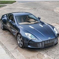 The Aston Martin is one of the most elegant grand tourer supercars available. Available in a couple or convertible The Aston Martin has it all. Aston Martin Lagonda, Carros Aston Martin, Aston Martin One 77, Aston Martin Cars, Luxury Sports Cars, Sexy Cars, Hot Cars, My Dream Car, Dream Cars