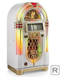 This classic jukebox commemorates the anniversary of Elvis Presley's first hit, made by Rock-Ola, leader in jukebox innovation for 80 years. Rock And Roll, Rock N Roll Music, Elvis Presley, Jukebox, Radios, Cascade Lights, Team Fortress 2 Medic, Cd Holder, Heartbreak Hotel