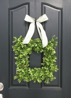 square wreath. add some holly, add a gold/red ribbon, and you have a modern xmas wreath