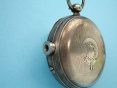 miniature pistol disguised within a pocket watch case