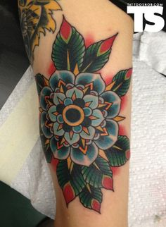 Flower tattoo by Brad Stevens (i am also digging this style lately)