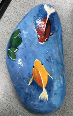 Rock painting of fish in a pond