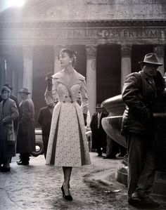 Model wearing a coat by Gattinoni, Rome, 1956. Photo by Elsa Haertter.// something about this is cool to me. maybe because my and husband and i had our picture taken almost in the exact spot where she's standing!