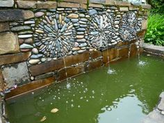 3 Round Medallion Mosaics mounted in a fountain wall - by Mosaic Artist Jeffrey Bale from Portland, OR