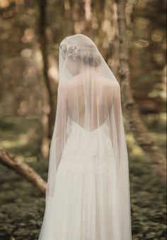 This is a very old world look with the veil covering head to toe, front and back.