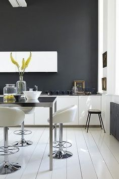 Gorgeous grey kitchen design with small kitchen bar and white glossy bar stools also white kitchen cabinet and white painted wooden floor. Small Kitchen Bar, Dark Grey Kitchen, Kitchen Ideas, Timber Kitchen, Nice Kitchen, Kitchen Corner, Kitchen Inspiration, Kitchen Tips, Küchen Design