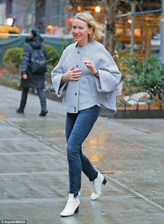 Looking cosy:Naomi Watts, 49, stepped out in fashionable form despite the rainy weather i...