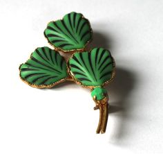 Vintage green shamrock like brooch for sale on Etsy