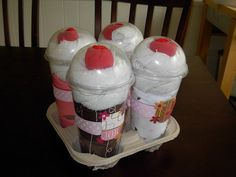 """Contains 4 Onesies, 4 Diapers, 8 White Wash Cloths, 4 red """"cherry"""" socks in clear cups with dome lid. LOVE."""
