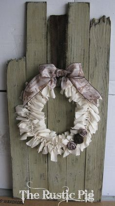- The Rustic Pig - Wonderful rag wreath on old used boards or fencing