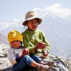 Two girls eating apples in the Andes. My entry to the Macallan Masters of Photography contest. Vote for me please!