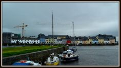 """Another view of the """"Long Walk"""" area of Galway City. Lovely colourful houses across the river Corrib"""
